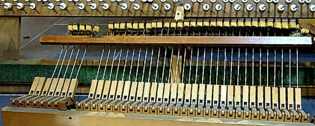 Plenty of reusable wood, wire and felt in the guts of this old piano.